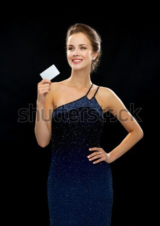 Stock photo: woman in evening dress with vip card