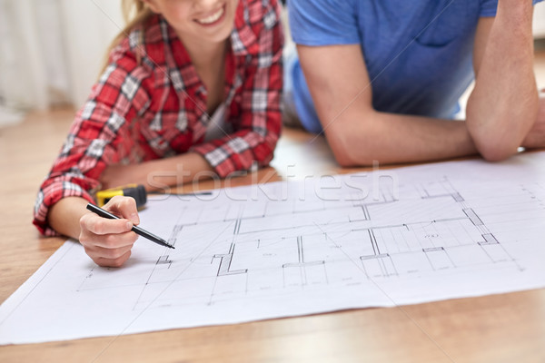 close up of couple with  blueprint at home Stock photo © dolgachov