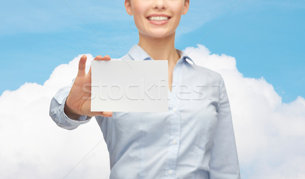 smiling businesswoman showing white blank card Stock photo © dolgachov