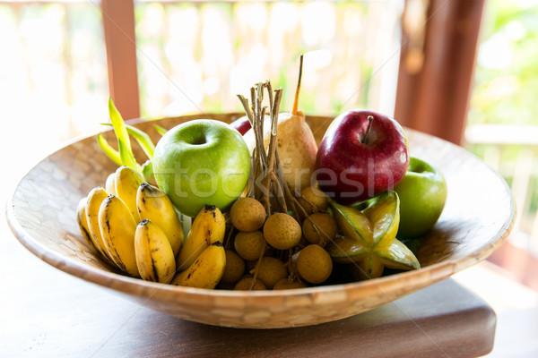 still life with exotic tropical fruits Stock photo © dolgachov