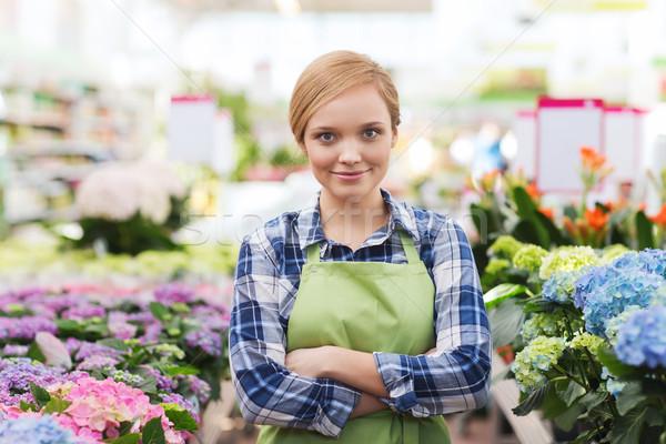 Szczęśliwy kobieta kwiaty szklarnia ludzi ogrodnictwo Zdjęcia stock © dolgachov