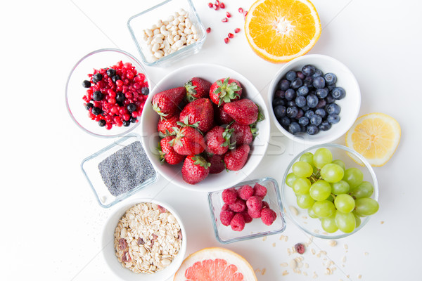 close up of fruits and berries in bowl on table Stock photo © dolgachov
