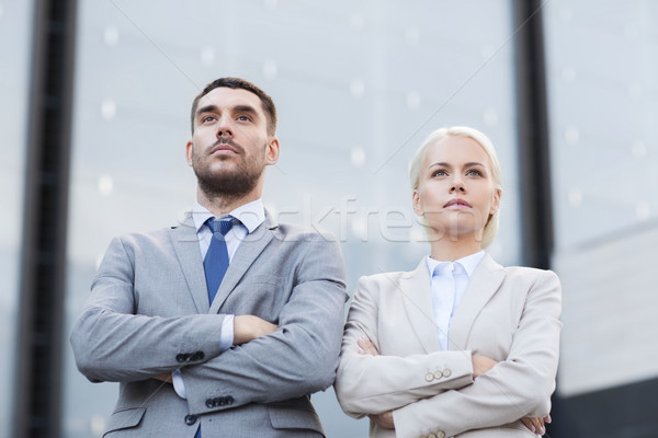 serious businessmen standing over office building Stock photo © dolgachov