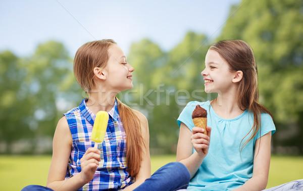 happy little girls eating ice-cream in summer park Stock photo © dolgachov