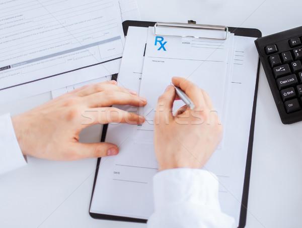 Mężczyzna lekarz piśmie recepta papieru rodziny Zdjęcia stock © dolgachov