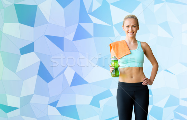 woman with bottle of water and towel Stock photo © dolgachov