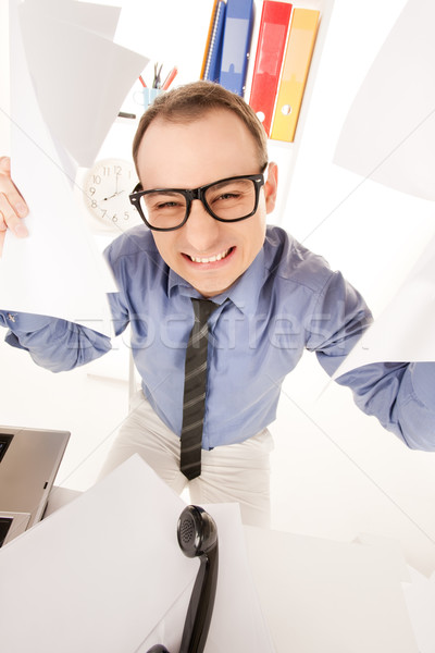 funny picture of businessman in office Stock photo © dolgachov