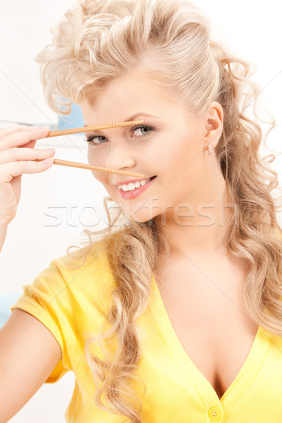 lovely woman with chopsticks Stock photo © dolgachov