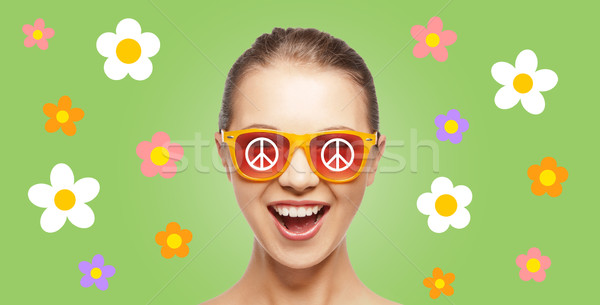happy teenage hippy girl in shades with peace sign Stock photo © dolgachov