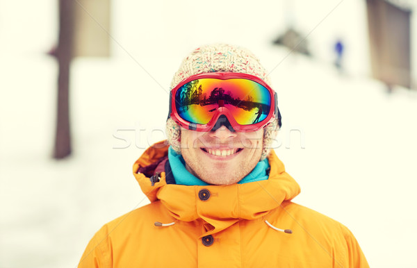 happy young man in ski goggles outdoors Stock photo © dolgachov