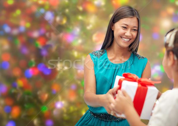 happy mother giving christmas present to her child Stock photo © dolgachov