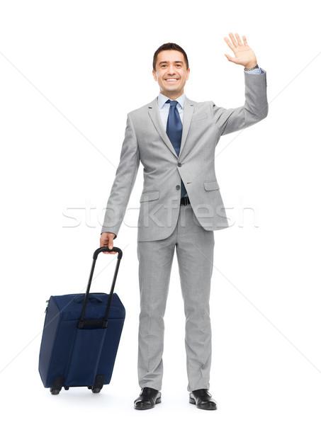 Boldog üzletember öltöny utazás táska üzleti út Stock fotó © dolgachov