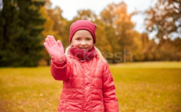 happy little girl waving hand in autumn park Stock photo © dolgachov