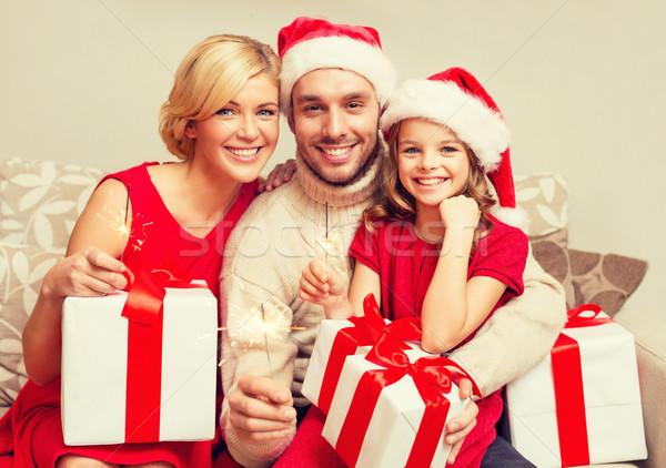 Mosolyog család tart ajándékdobozok karácsony karácsony Stock fotó © dolgachov
