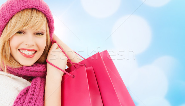 woman in pink hat and scarf with shopping bags Stock photo © dolgachov