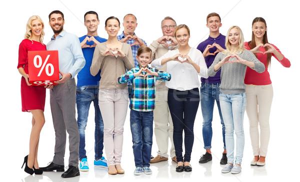 Gens heureux pourcentage signe coeur personnes Photo stock © dolgachov