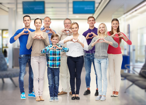 group of smiling people showing heart hand sign Stock photo © dolgachov