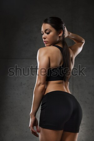 young woman posing and showing buttocks in gym Stock photo © dolgachov