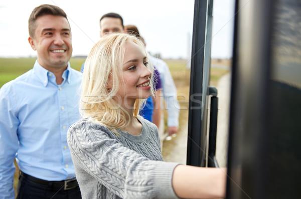 group of happy passengers boarding travel bus Stock photo © dolgachov
