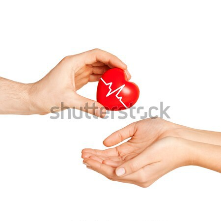 Uomo mano rosso cuore donna carità Foto d'archivio © dolgachov