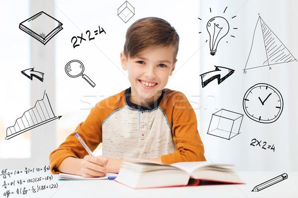Stock fotó: Mosolyog · diák · fiú · ír · notebook · otthon