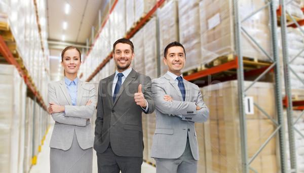Gelukkig business team magazijn tonen groothandel Stockfoto © dolgachov