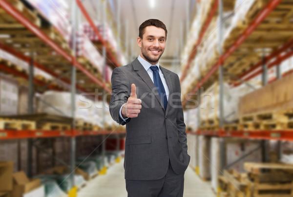 Gelukkig man magazijn tonen gebaar Stockfoto © dolgachov