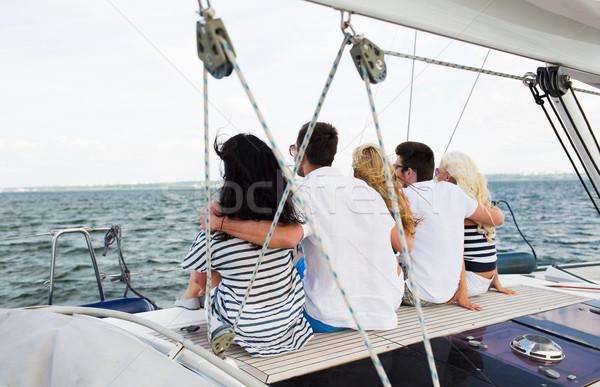 幸せ 友達 セーリング 座って ヨット デッキ ストックフォト © dolgachov