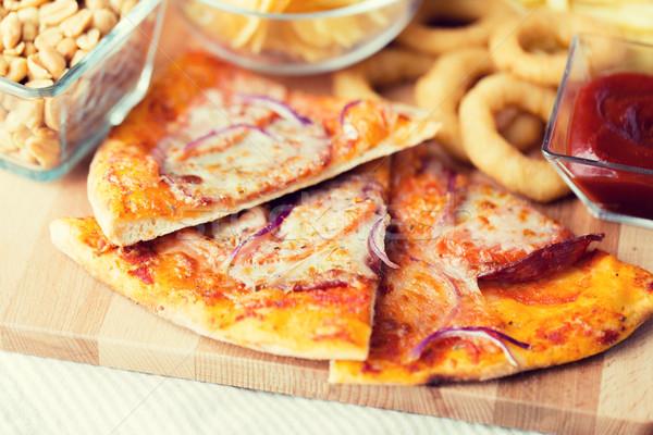 Pizza autre collations table en bois restauration rapide Photo stock © dolgachov