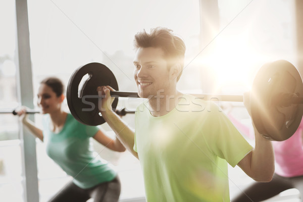 group of people exercising with barbell in gym Stock photo © dolgachov