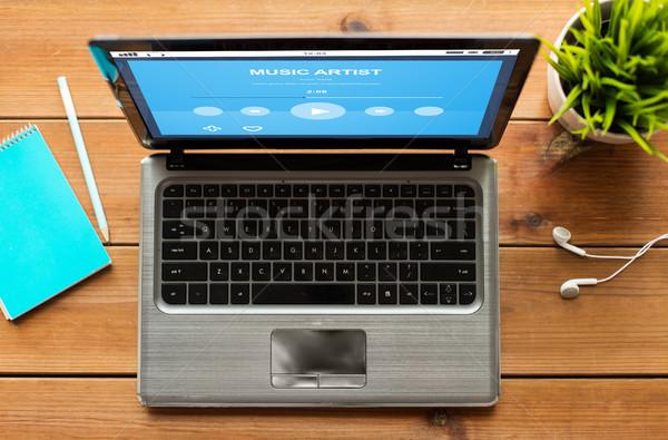 Laptop music player tabela educação negócio Foto stock © dolgachov