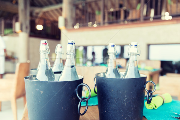 bottles of water in ice bucket at hotel restaurant Stock photo © dolgachov