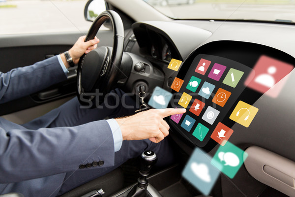 man driving car with menu icons on board computer Stock photo © dolgachov