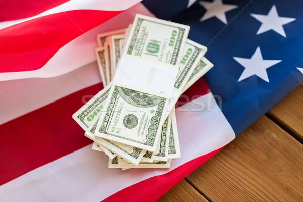 close up of american flag and dollar cash money Stock photo © dolgachov