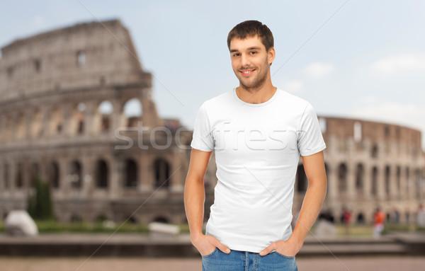 happy man in blank white t-shirt over coliseum Stock photo © dolgachov