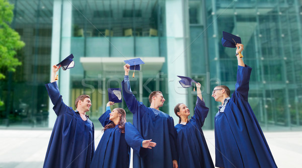 group of smiling students with mortarboards Stock photo © dolgachov