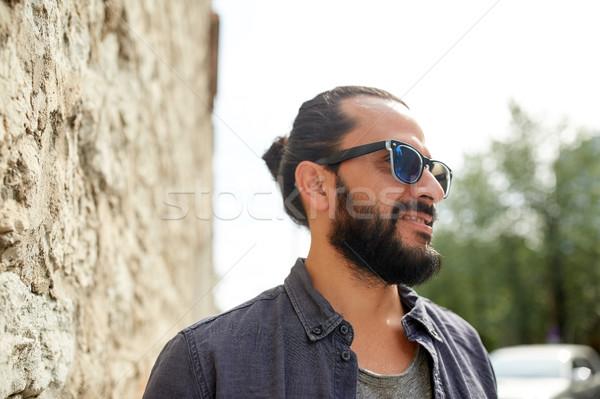 happy smiling man with beard on city street Stock photo © dolgachov
