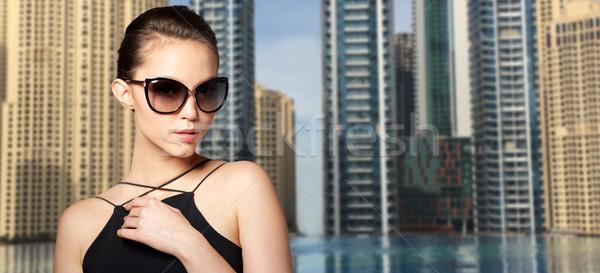 beautiful young woman in elegant black sunglasses Stock photo © dolgachov
