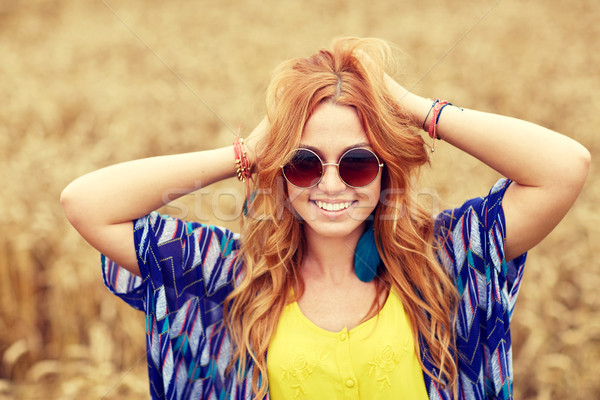 smiling young redhead hippie woman outdoors Stock photo © dolgachov