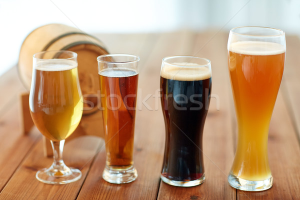 close up of different beers in glasses on table Stock photo © dolgachov