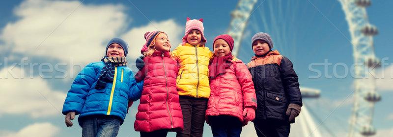 Gelukkig weinig kinderen gezichten pont wiel Stockfoto © dolgachov