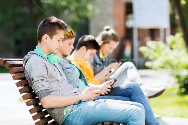 Boldog tizenéves fiú táblagép fejhallgató technológia internet Stock fotó © dolgachov