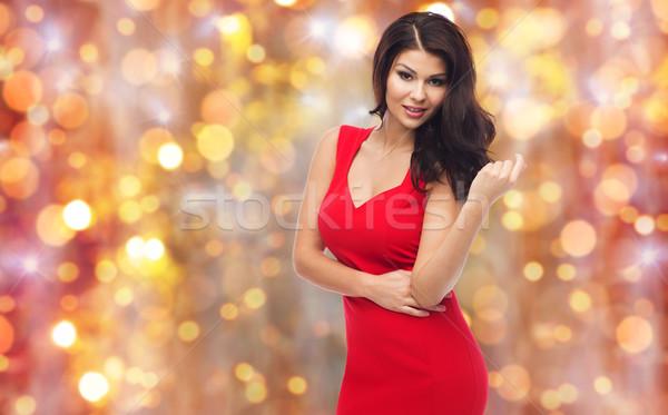 Güzel seksi kadın kırmızı elbise insanlar tatil moda Stok fotoğraf © dolgachov