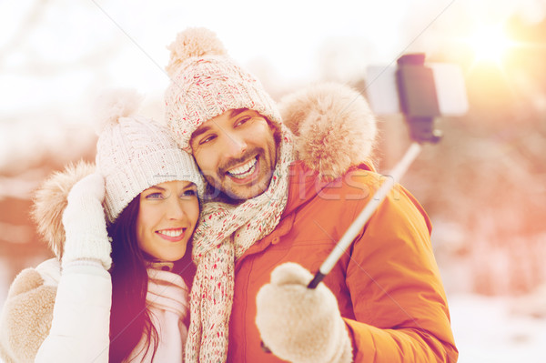 happy couple taking selfie by smartphone in winter Stock photo © dolgachov