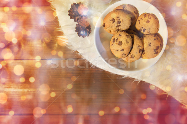 christmas cookies in bowl and cones on fur rug Stock photo © dolgachov