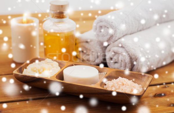 soap, himalayan salt, scrub in bowl, towel and oil Stock photo © dolgachov