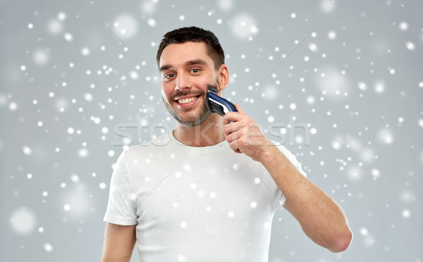 Glimlachend man baard sneeuw schoonheid Stockfoto © dolgachov