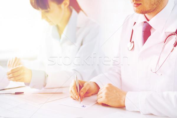 doctor and nurse writing prescription paper Stock photo © dolgachov