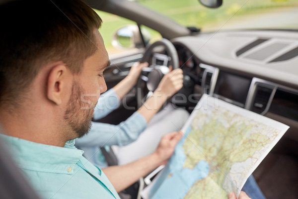 Paar rijden auto reizen kaart weg Stockfoto © dolgachov
