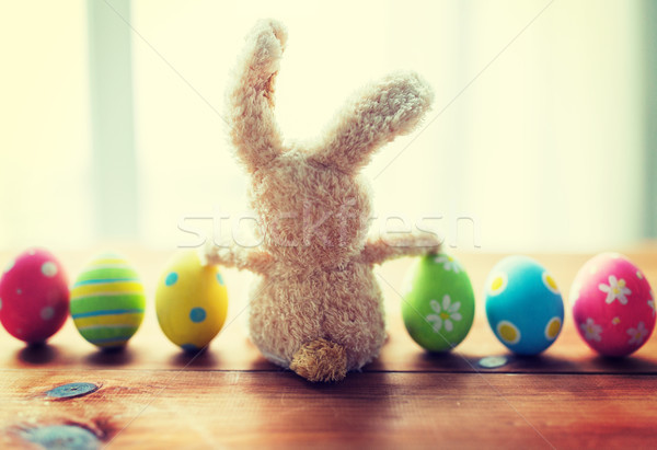 close up of colored easter eggs and bunny Stock photo © dolgachov